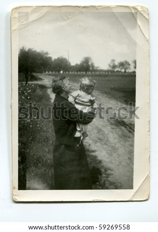 Vintage photo of grandmother and grandson