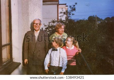 Vintage photo of grandparents with grandchildren (eighties)