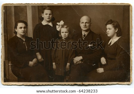 Vintage photo of happy family - stock photo