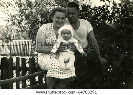 Vintage photo of happy family (1949)