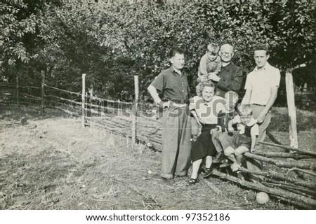Vintage photo of happy family outdoor (sixties) - stock photo