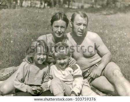 Vintage photo of happy parents with children (eighties)