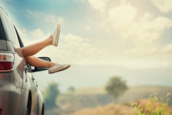 Vintage photo of leg woman in car during morning time holiday