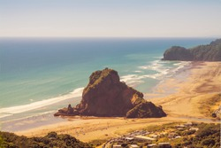 Vintage photo of Lion Rock in the centre of Piha beach. on a beautiful summer day. Auckland, New Zealand.