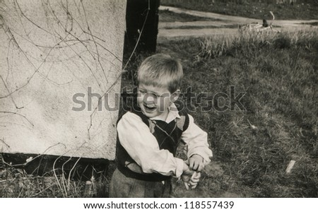 Vintage photo of little boy outdoor (eighties)