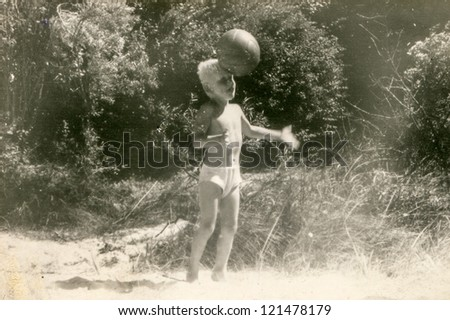 Vintage photo of little boy playing ball (fifties)