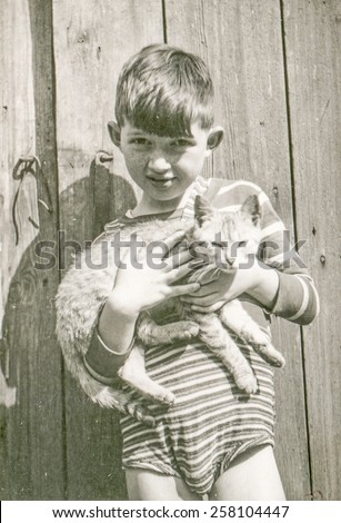 Vintage photo of little boy with a cat, 1950\'s