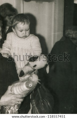Vintage photo of little girl during her first birthday (eighties)
