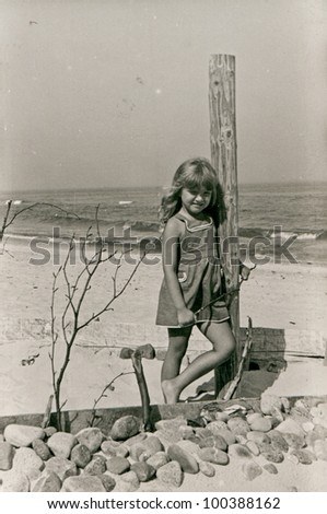 Vintage photo of little girl on beach (fifties)