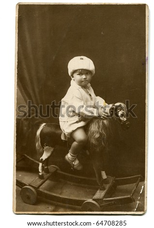 Vintage photo of little girl on rocking horse (circa 1928)
