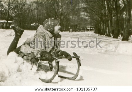 Vintage photo of little girl on sled (fifties)
