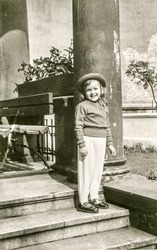 Vintage photo of little girl outdoor, 1950's