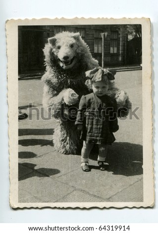 Vintage photo of little girl with fake bear