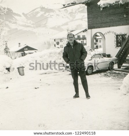 Vintage photo of man in mountain ski resort (fifties)
