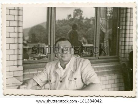 Vintage photo of man on balcony, fifties