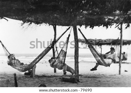 Vintage photo of 3 men in hammocks