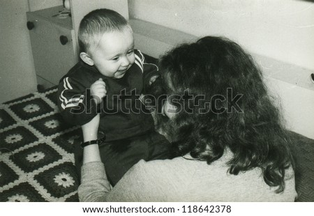 Vintage photo of mother and baby daughter (early eighties)