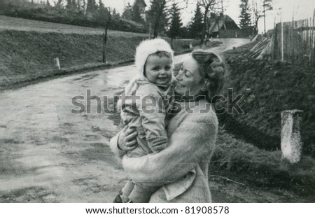 Vintage photo of mother and baby (fifties)