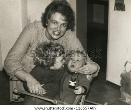Vintage photo of mother and children (eighties)