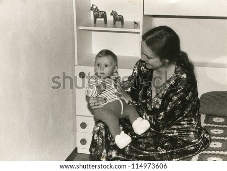 Vintage photo of mother and daughter, early eighties
