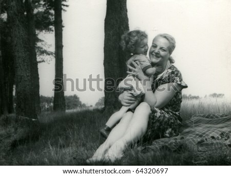 Vintage photo of mother with daughter (fifties)