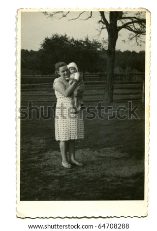 Vintage photo of mother with her baby (1949) - stock photo