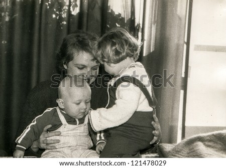 Vintage photo of mother with little children (early eighties)