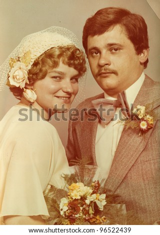 Vintage photo of newlyweds (seventies) - stock photo