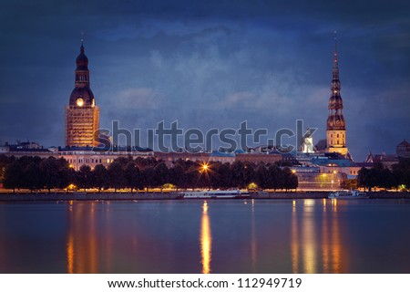 Vintage photo of night Riga cityscape. Latvia - stock photo