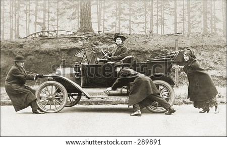 Vintage Photo of People Pushing Old Car