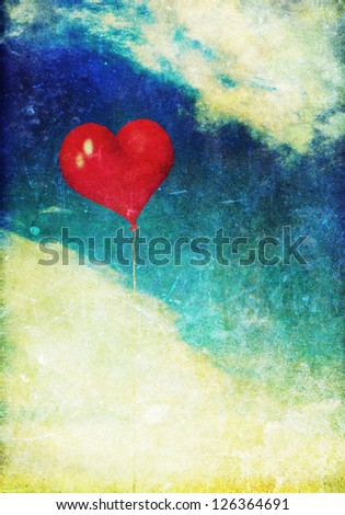 Vintage photo of red heart balloon