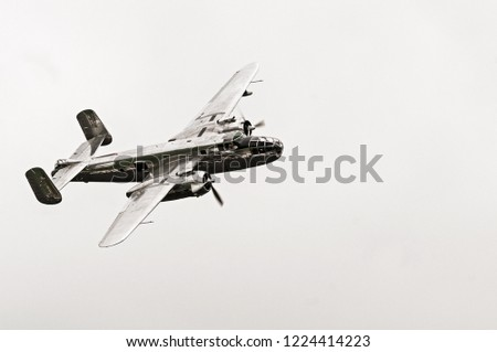 Vintage photo of silver North American B-25J Mitchell bomber aircraft isolated on white