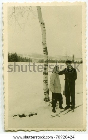 Vintage photo of skier and his wife (fifties)