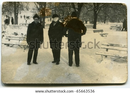 Vintage photo of three generations (early seventies) - stock photo