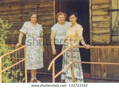 Vintage photo of three woman on terrace (seventies)