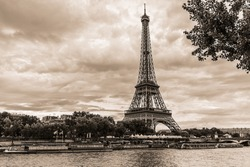 Vintage photo of Tour Eiffel (Eiffel Tower. Eiffel Tower, named after engineer Gustave Eiffel, is tallest structure in Paris and most visited monument in the world. Champ de Mars, Paris France.