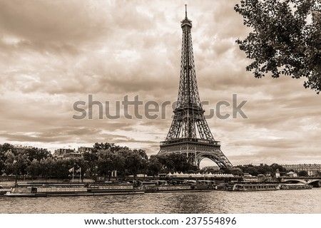 Vintage photo of Tour Eiffel (Eiffel Tower. Eiffel Tower, named after engineer Gustave Eiffel, is tallest structure in Paris and most visited monument in the world. Champ de Mars, Paris France. stock photo