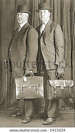Vintage photo of Two Businessmen With Briefcases