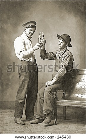 Vintage Photo of Two Men Toasting With Beer