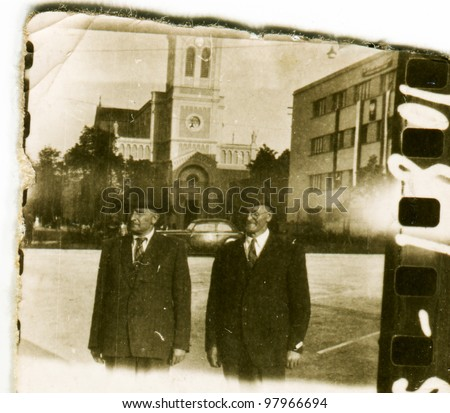 Vintage photo of two men walking (fifties)