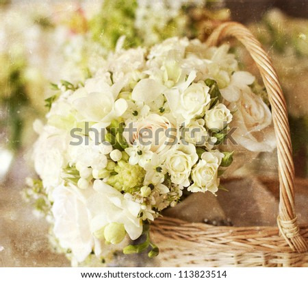 Vintage photo of white roses in a basket