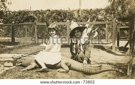 Vintage photo of woman and girl riding an alligator