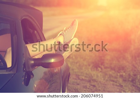 stock photo vintage photo of woman s legs in retro shoes out of car windows in summer sunset 206074951 - Каталог — Фотообои «Ретро»