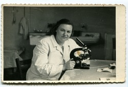Vintage photo of woman with microscope