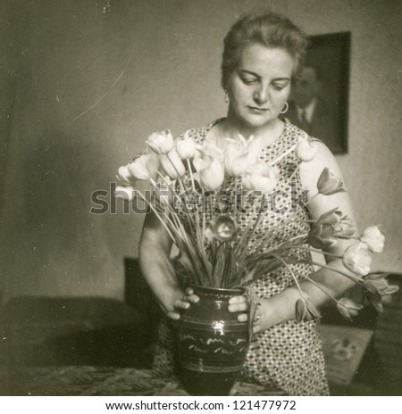 Vintage photo of woman with tulips (fifties)