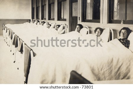 Vintage photo of women in beds -- maternity ward?