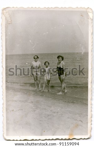 Vintage photo of women with girl on beach (fifties)