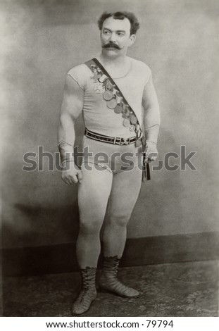 Vintage photo of wrestler with medals