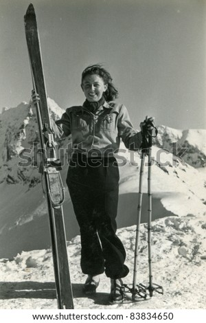 Vintage photo of young female skier (forties)
