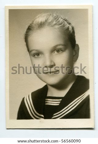 Vintage photo of young girl in school uniform (1961)